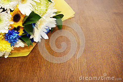Bouquet of flowers lying on a wooden surface