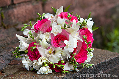 Bouquet of flowers of white and red colors of orchids and roses for a wedding ceremony