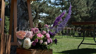 Bouquet of fresh flowers and event decoration in a green park. Decoration events. Preparation for the holiday.  stock footage