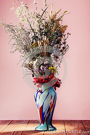 Free Bouquet Of Field Dried Flowers In Vintage Blue Vase Stock Photos - 99763603