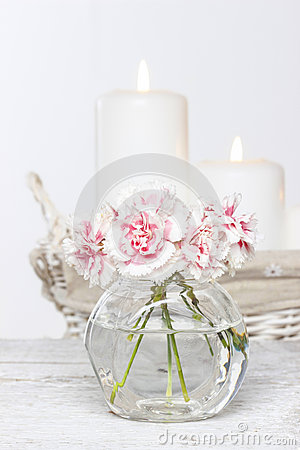 Bouquet of pink carnations in small glass vase