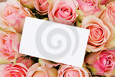 Bouquet of pink  roses in basketwith greeting card