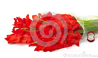Bouquet of red gladiolus, wedding ring in box