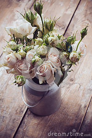 Bouquet of roses in metal pot