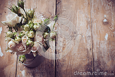 Bouquet of roses in metal pot