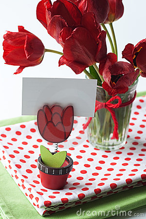 Bouquet of tulips and a polka dot tablecloth
