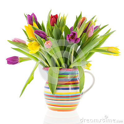 Bouquet tulips in vase with stripes