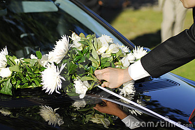 Bouquet on wedding car