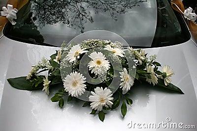 Bouquet on a wedding car