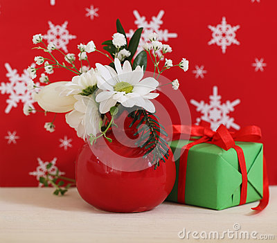 Bouquet of winter flowers with present