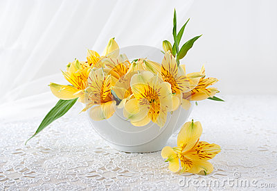 Bouquet of yellow flowers stands on a table