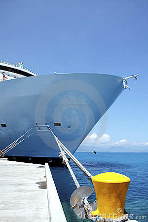 Bow of Cruise Ship Tied to Yellow Bollard