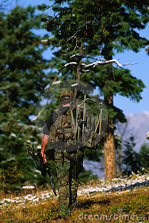 Bowhunter Carrying a Treestand