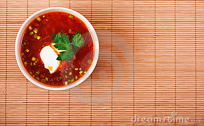 Bowl of borscht on bamboo table