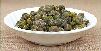 Bowl of capers on tan cloth