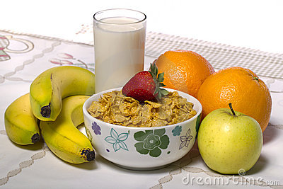 Bowl of cereals with fruit and milk