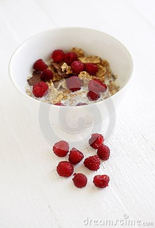 Bowl with cereals and raspberries