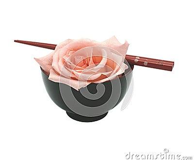 Bowl, chopsticks and rose