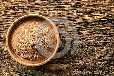 Bowl of cinnamon powder