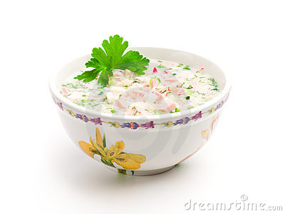 Bowl of cold soup with chopped vegetables