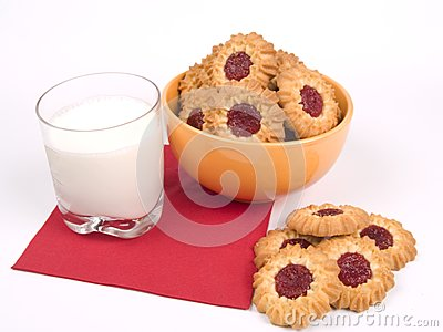 Bowl of cookies with glass of milk