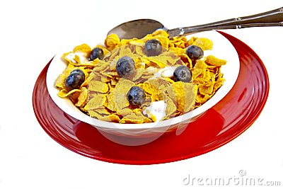 Bowl of corn flakes with fresh blueberries