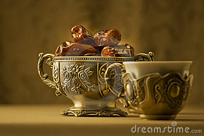 A bowl of dates and tea.