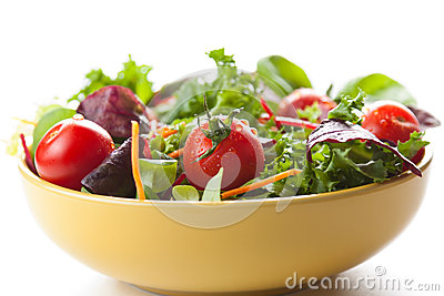 Bowl of fresh green salad with tomatoes