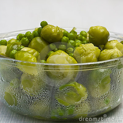 Bowl of freshly steamed peas and vegetables