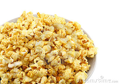 Bowl full of caramel popcorn. Isolated