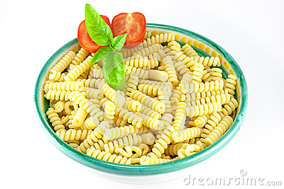 Bowl of fusilli pasta with tomatoes and basil