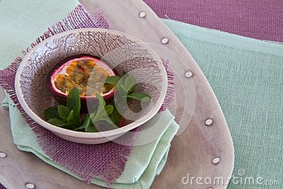 Bowl of granadilla on colorful linen
