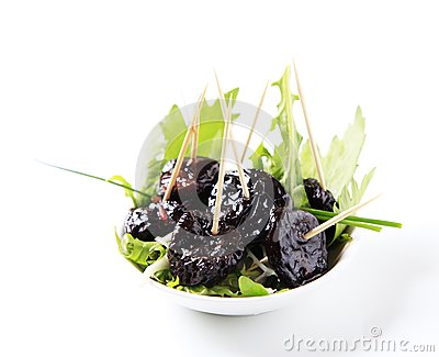 Bowl of greens and prunes