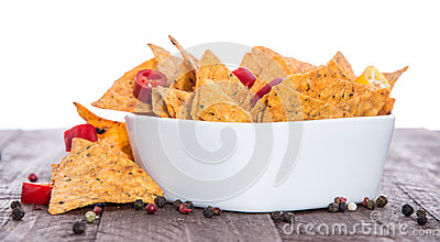 Bowl of Nachos on white and wood