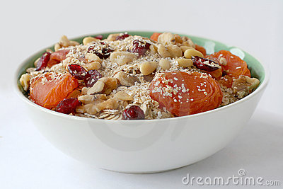 Bowl of oatmeal with nuts and fruits
