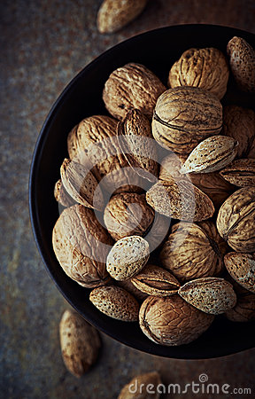 Free Bowl Of Rustic Walnuts And Almonds Stock Photo - 29939050
