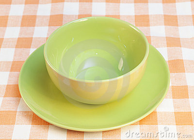 Bowl and plate on checkered tablecloth