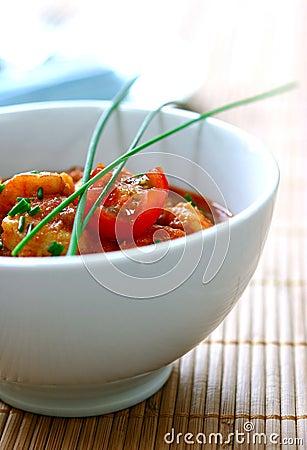 A bowl of prawn masala curry