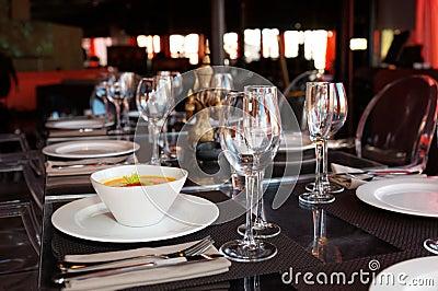 Bowl of pumpkin soup on restaurant table