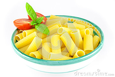 Bowl of rigatoni pasta with tomatoes and basil