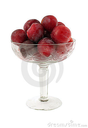Bowl with ripe plums