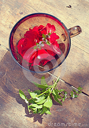 The bowl with rose petals and mint