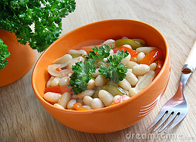 A bowl of stewed beans and vegetables.