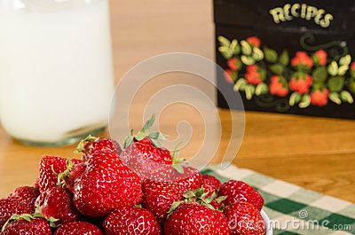 Bowl of strawberries with recipe box