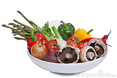Bowl of vegetables isolated on white.