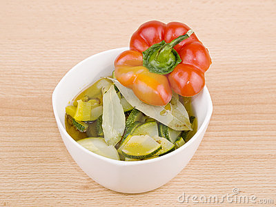 Bowl of vegetarian soup on wooden background