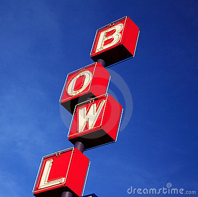 Bowling rink sign red blue sky