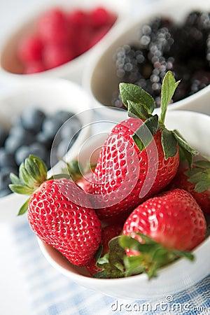 Bowls of ripe summer berries