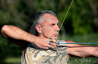 Bowman aiming with bow and arrow