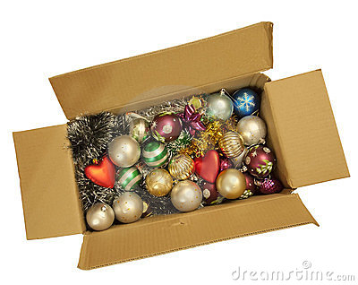 Box with a Christmas tinsel and New Year s toys.